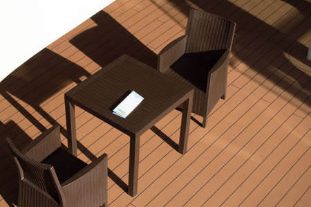 Dark table and chairs of the restaurant on the open deck of the cruise ship, top view