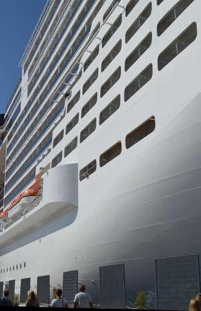 Luxury white cruise ship on blue sky background close-up