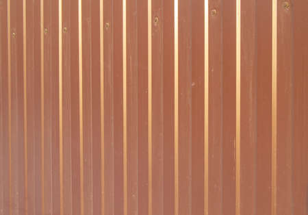 Brown metal siding, modern finishing material for the manufacture of fences and exterior wall cladding. 写真素材