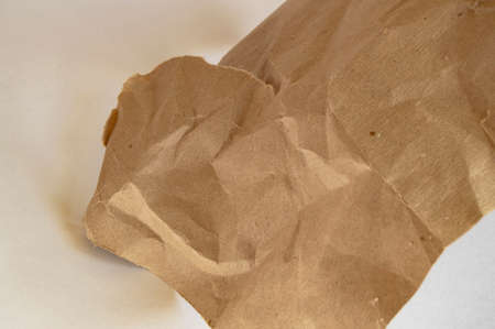 Recycling beige natural crumpled vintage paper on grey background. Imagens