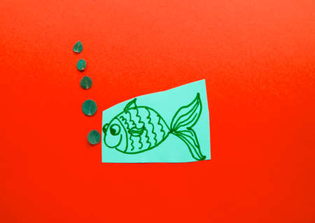 Funny fish with bubbles on red background, fool's Day. Banco de Imagens