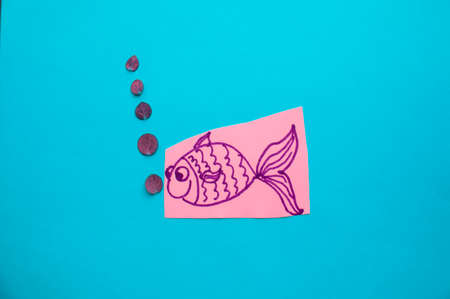 Funny fish with bubbles on blue background, fool's Day.