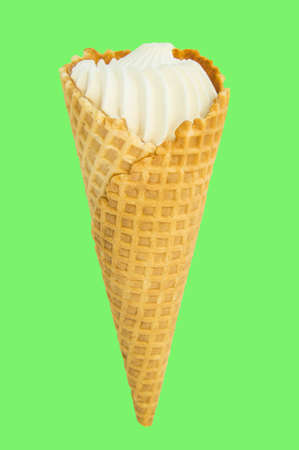 Ice cream cone vanilla on green background. Vertical shot, clipping, isolated, copy space.