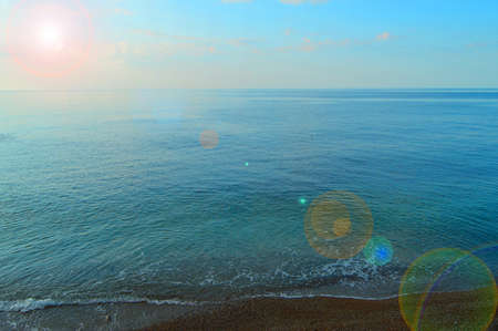 Calm sea ocean and blue sky background, sunrise over the sea, beautiful background. 免版税图像