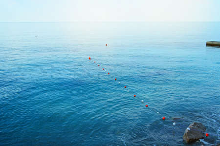 Separation buoys in the sea for safe swimming on the beach.