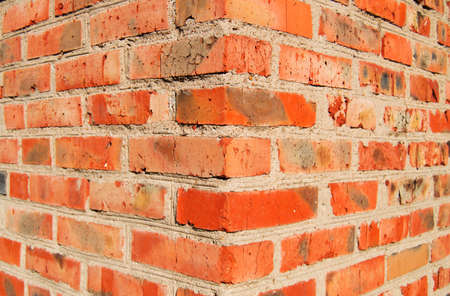 The outer corner of old brick wall.