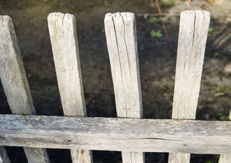 Old gray wooden fence from the cracked boards. Reklamní fotografie