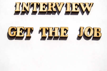 Wooden letters with a sharp shadow on a white background written word interview get the job search, the concept of interview for employment , recruitment.