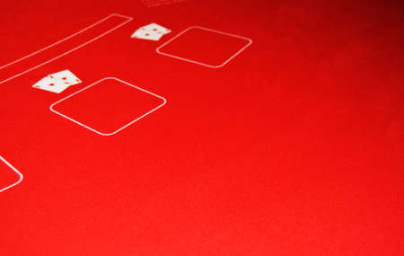 Game table covered with red cloth for casino gambling, two pairs of aces, the concept of luck, luxury, wealth, leisure, selective focus, blur, copy space for text. Banco de Imagens