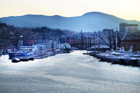 Panorama of the old port with port cranes, sea view, early in the morning, at dusk and early sunrise, Genoa, Italy. Banco de Imagens