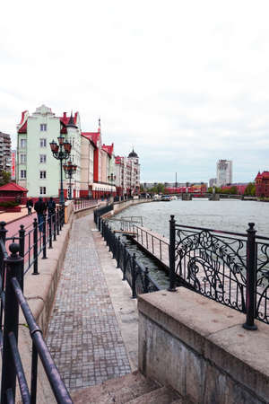 Multi-colored houses along the waterfront in the cultural and ethnographic center of the Fishing village, Kaliningrad, Russia, vertical frame
