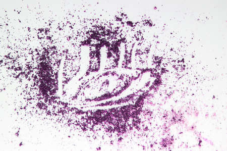 The concept of makeup eyeshadow blue lilac and purple scattered on a white isolated background