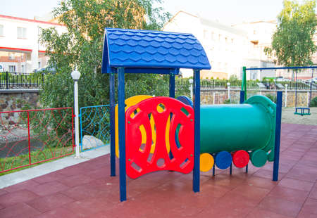Childrens Playground with funny train made of multi-colored plastic and metal material, entertainment for children outdoors in the Park in summer during the holidays.