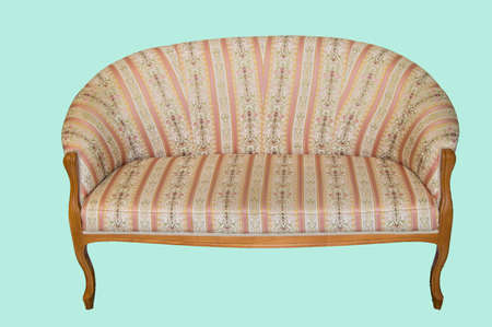 Classic elegant sofa with textile upholstery and wooden legs, made in vintage retro style, marble floor and walls in the living room of a luxury hotel, isolated on a pastel blue background. Banco de Imagens