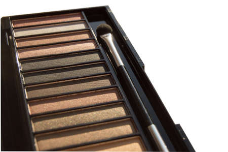 Natural brown Nude eyeshadow palette close-up, with tassel isolated on white background.