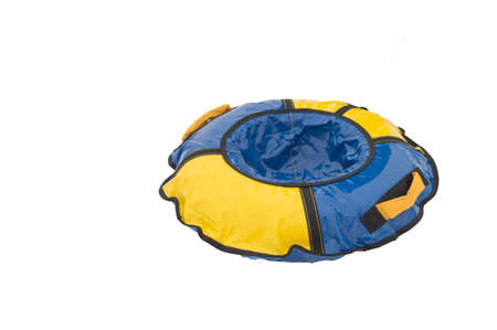 Childrens inflatable rubber round sled tubing for winter ride with slides, blue-yellow isolated on white background by clipping.
