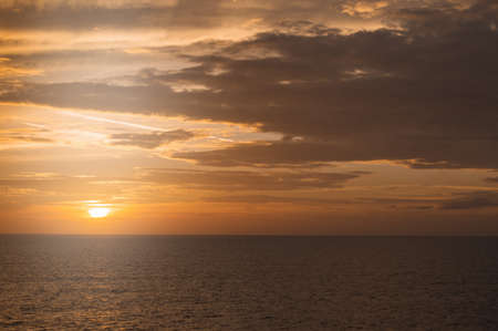 Golden dramatic sunset over the Mediterranean sea, beautiful natural background, tranquility and harmony in nature, the concept of travel and sea cruises.