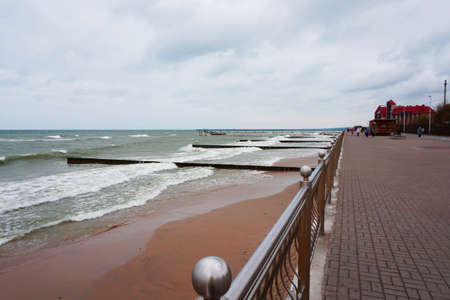 Promenade overlooking the Baltic sea with pier and breakwaters in Kaliningrad, Russia, may 2019, seascape..