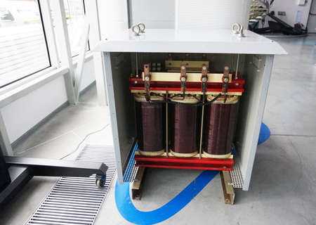 Transformer with electric motor coil, in modern production room.