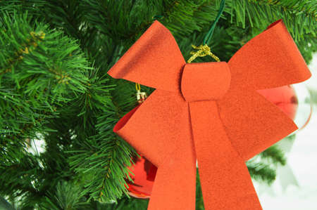 A bright red bow on the Christmas tree, concept, decoration, Christmas background