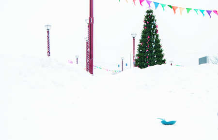 Christmas tree decorated with red and silver bows and balls, on the background of snow outdoors in the Park in winter. Фото со стока