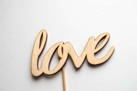 Wooden word love on white background, for holiday decoration, template for design 版權商用圖片