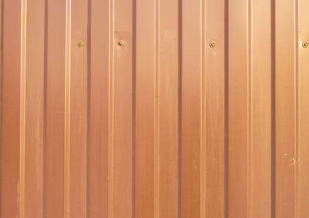 Brown siding background texture corrugated metal material for wall and fence veneer. 版權商用圖片