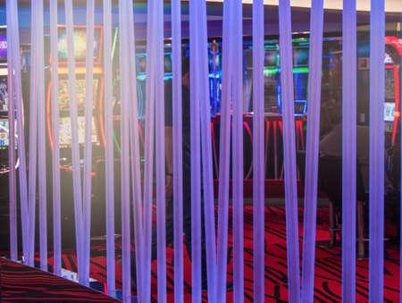 Neon glowing tubes in the interior of the casino, dark background. Zdjęcie Seryjne