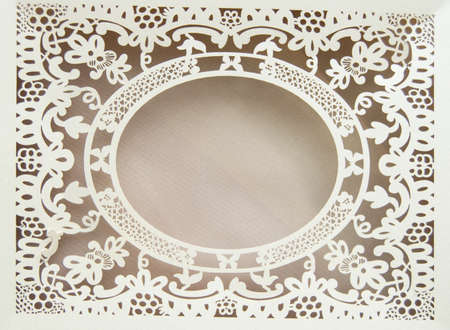 White paper hollow lace oval frame, done in the ornate and luxurious style on a pink background, place for text, room for copy.