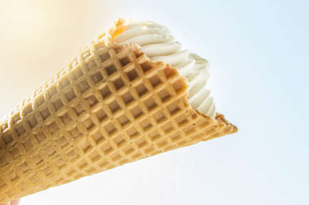 Vanilla ice cream cones on white background, delicious dessert on bright sunlight background. 版權商用圖片