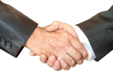 Close-up of a business handshake between two businessmen in business suits isolated on a white background. 免版税图像