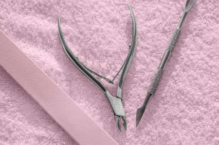 Nail kit tools on a pink background, care and Spa.