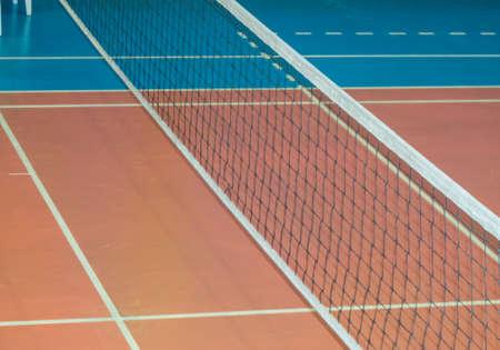 Modern empty school gym indoor with volleyball net.
