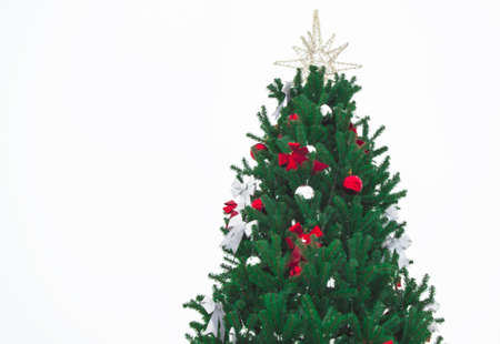 Beautiful Christmas tree decorated with balloons, bows and a star on a white background.