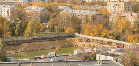 Construction site in a residential area of Moscow, dug in the ground pit filled with water, top view