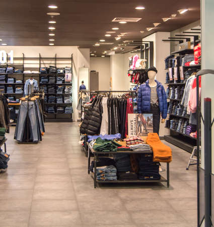 Europolis, Moscow, Russia - October 8, 2019: interior of fashion boutiques with modern clothing