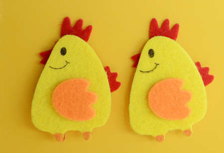 two cute yellow felt chickens handmade, diy, kids easter crafts, copy space, funny handmade idea. Banco de Imagens