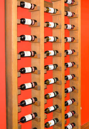 Balaklava, Crimea, Russia-June 2, 2018: Storage of wine bottles on wooden shelves in a wine shop. Collectible wine bottles. Editorial