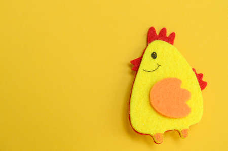 Easter one chicken handmade on yellow background, DIY concept, copy space, flat lay, easter concept