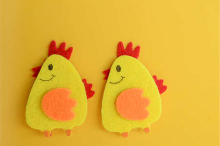 two cute yellow felt chickens handmade, diy, kids easter crafts, copy space, funny handmade idea Banco de Imagens