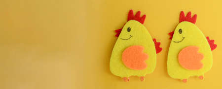 two cute yellow felt chickens handmade, diy, kids easter crafts, copy space, funny handmade idea, banner Banco de Imagens