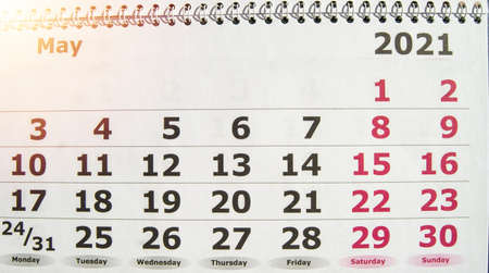 May 2021 calendar with a spiral, the concept of a business planner of important things and dates. 免版税图像