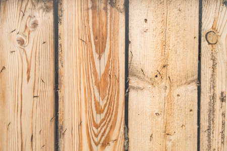 New planed boards, wood texture with cracks and knots, wooden background.