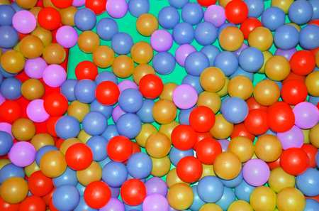 Background, colorful plastic colorful balls on the playground, pool with balls for children's development and games. Stok Fotoğraf