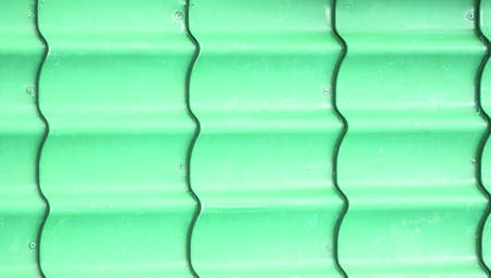 Corrugated corrugated metal sheet, green color, siding for walls and roofs, background, texture Stok Fotoğraf
