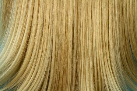 Close-up of woman beautiful blond straight long hair texture, hairstyle background