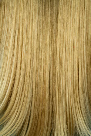 Close-up of woman beautiful blond straight long hair texture, hairstyle background 版權商用圖片