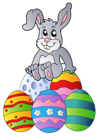 Bunny on pile of Easter eggs  Ilustracja
