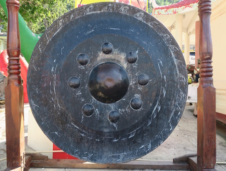 sound therapist: Gong at a temple, Thailand