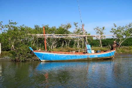A traditional fishermens sailing boat on the water, Thailand